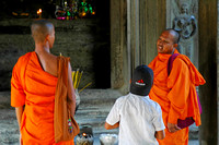 Monks and Boy with Adidas Cap
