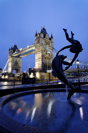 Girl with Dolphin Statue and Tower Bridge